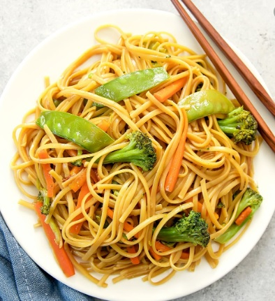shrimp chow mein in a serving plate