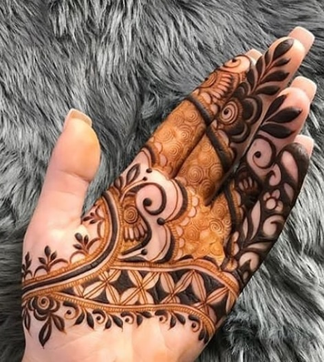 cool henna design on hand front