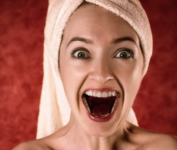 A girl with clean and healthy teeth and open mouth