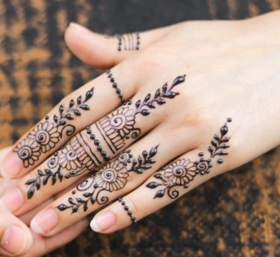 henna design on back hand side