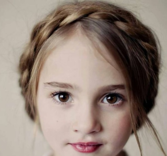 a girl with French crown braid