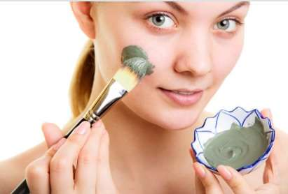 A girl is applying mint Leaves face pack for face glow