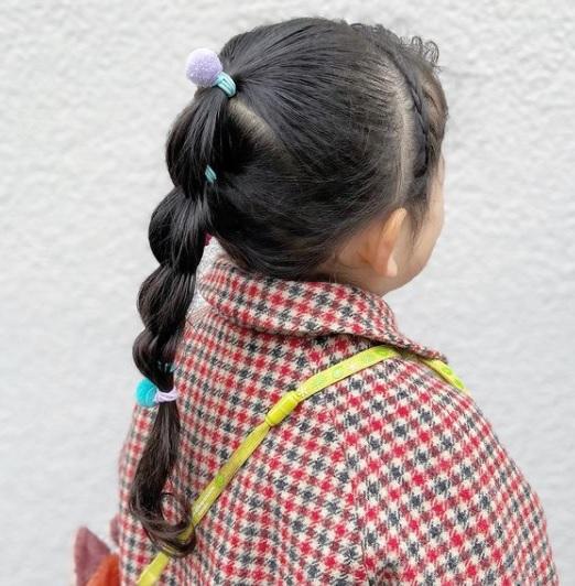 little girl with diamond braid ponytail
