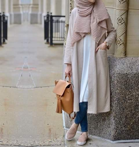 a girl with Hijab and Skinny Jeans holding bag in hand