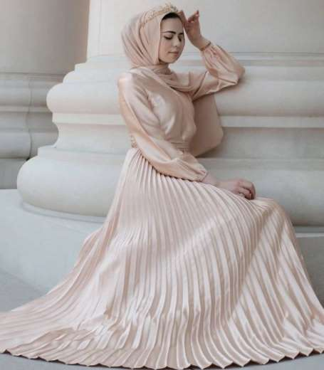 girl is sitting with golden silk Latest Fashion Hijab with Outfit