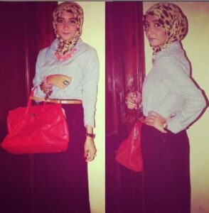 a girl holding a bag in her hand wearing Egyptian Hijab Style