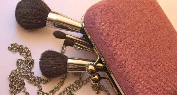 Girls handbag with chain and makeup brushes